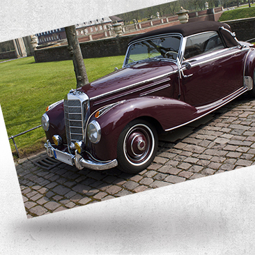 Classic car in castle courtyard by Bink Creations
